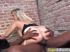 Hot cougar Amber Lynn Bach blowjobs black cock in jail