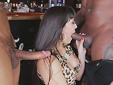 Busty brunette bartender sucks two black dicks and gets fucked