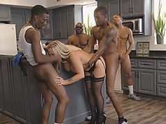 Slutty Cougar Amber Lynn Bach Gets Shared Between Horny Black Men