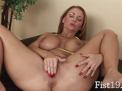 Nasty beauty fisting herself