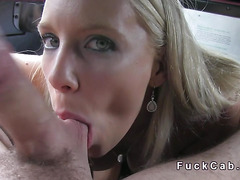 Busty blonde sucks shaved balls in cab