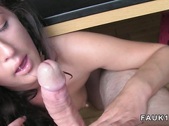 Brunette babe sucks cock under desk