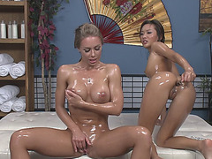 Two tender pussies gets filled with oil and probed by a glassy sex toy