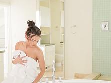 Beautiful Adriana gets naked inside the bathroom and masturbates