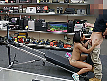 Fit girl works out in a pawn shop