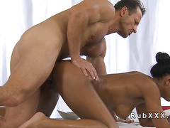 Tanned hottie got hard masseurs cock