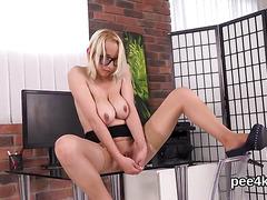Enchanting girl is peeing and masturbating hairless slit