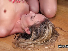 Cute chick is geeting pissed on and squirts wet pussy