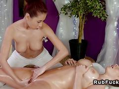 Redhead masseuse oils and fucks busty brunette