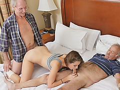 Two horny old studs share one petite brunette and young pussy