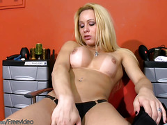 Perfect blonde shemale poses in black dress and wanks off