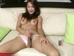 Long haired ladyboy in pink panties jerks off her big dick