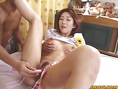 Rowdy Sakura plays with a big toy on her pussy through her pants