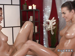 Oiled lesbians tribbing in massage room