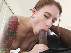 Tattoed brunette in anal drilling action with big black cock