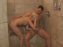 Captivating blonde lady takes shower with client and gives him sensual blowjob