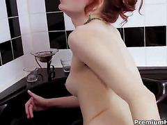 Wet milf pleasuring herself in bath