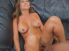 Busty brunette takes huge black schlong on couch