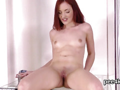 Striking kitten is pissing and rubbing shaven snatch