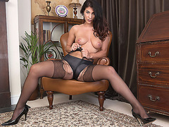 Horny brunette Roxy Mendez rips open black nylon pantyhose and satin panties to play toy juicy pussy