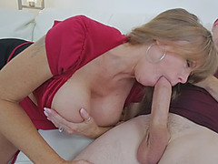 A slutty busty stepmom takes stud's big dick and sucks it passionately