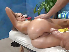 Riley is a cute 18 year old brunette with perfect tits. After getting her booty rubbed with massage oil she was practically begging to be fucked hard