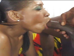 Cali Sunshine is a voluptious black chic, who is sitting in her couch,