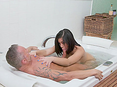 Lovely brunette masseuse gets boned on nuru massage bed
