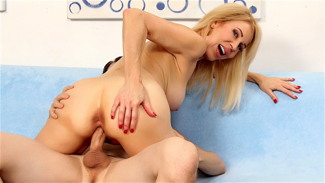 young stud hammering a busty mature