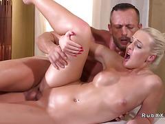 Blonde masseuse gets cum after sex