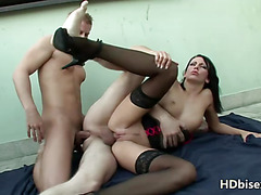 Stocking-clad brunette with a sexy ass enjoying threeway fun