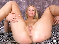 Natural sweetie is stretching narrow kitty in close-up and getting off