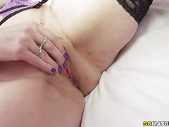 British housewife Beau Diamonds playing with her toys