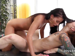 Cute lesbo chicks get splashed with pee and squirt wet vaginas