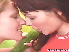 Teenie licks whip cream off her friends pussy