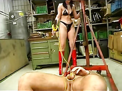 Mistress plays with her slaves cock
