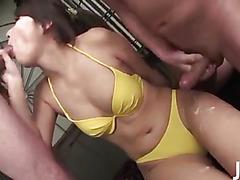 Four guys surround Mai Asahina taking turns stuffing her mouth with their hard dicks