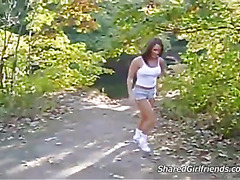 Hot brunette show of her body outdoors