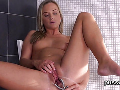 European cutie enjoys speculum and pushes huge sex toy in pussy