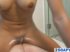 Thai girl massages a big white cock with her soapy pussy