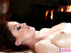 Karlie Montana gives kinky massage to Megan Rain pussy