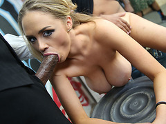 Katie Kox lined up by many black dudes