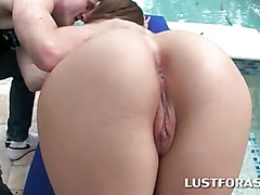 Hottie tanning by the pool gets butt licked