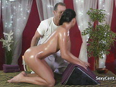 Oiled brunette fucking on massage