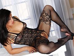 Sexy masseuse received cum on her feet