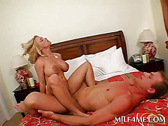 Sensual MILF licks cock and rides it on reverse