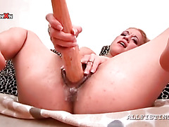Blonde slut drills wet pussy with a baseball bat